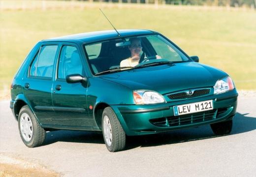 MAZDA 121 hatchback zielony przedni prawy