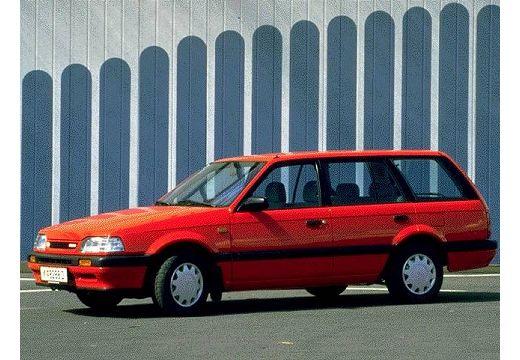 MAZDA 323 kombi czerwony jasny przedni lewy
