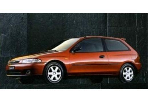 MAZDA 323 hatchback brązowy przedni lewy
