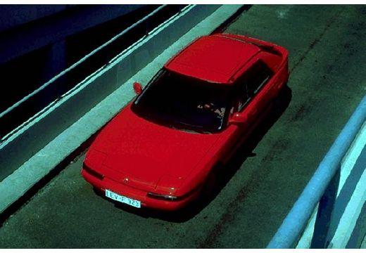 MAZDA 323 hatchback czerwony jasny górny przedni