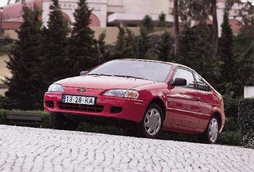 Toyota Paseo coupe czerwony jasny przedni lewy