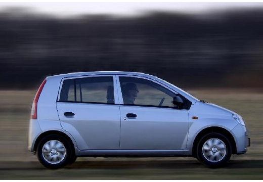 DAIHATSU Cuore VI hatchback silver grey boczny prawy