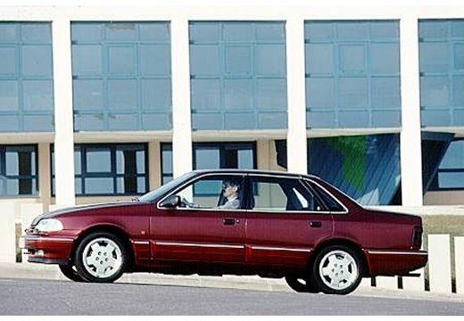 FORD Scorpio I sedan bordeaux (czerwony ciemny) boczny lewy