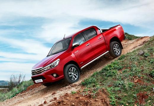 Toyota HiLux pickup czerwony jasny boczny lewy